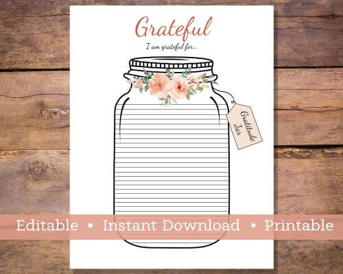 A piece of white paper with a Jar on it.  The jar has a flowers around the top and it is lined to write in what you are grateful for.
