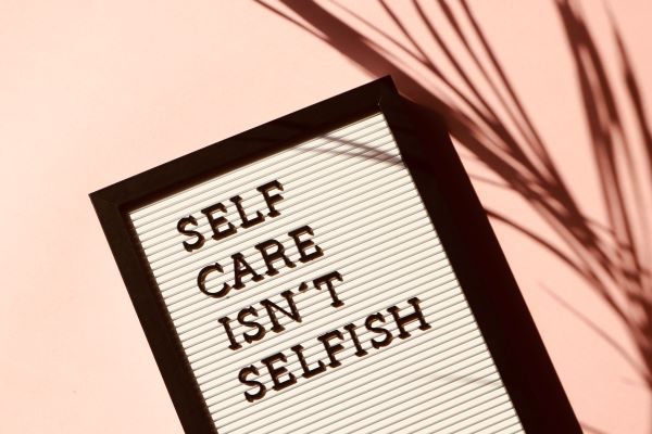 "Sign: ""Self Care Isn't Selfish"" when living your life to the fullest"
