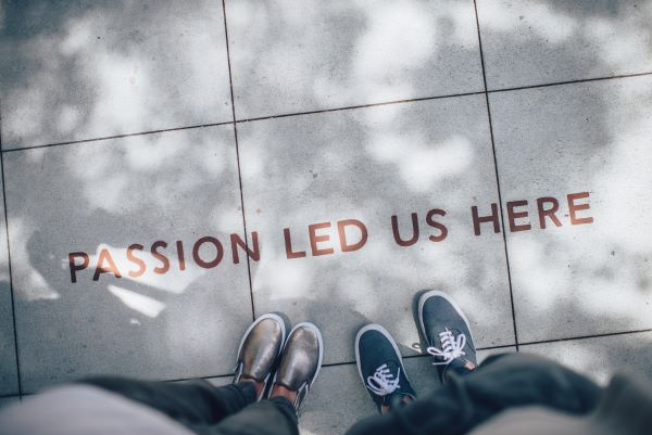 """Passion led us here"" written on sidewalk - Live your life to the fullest"