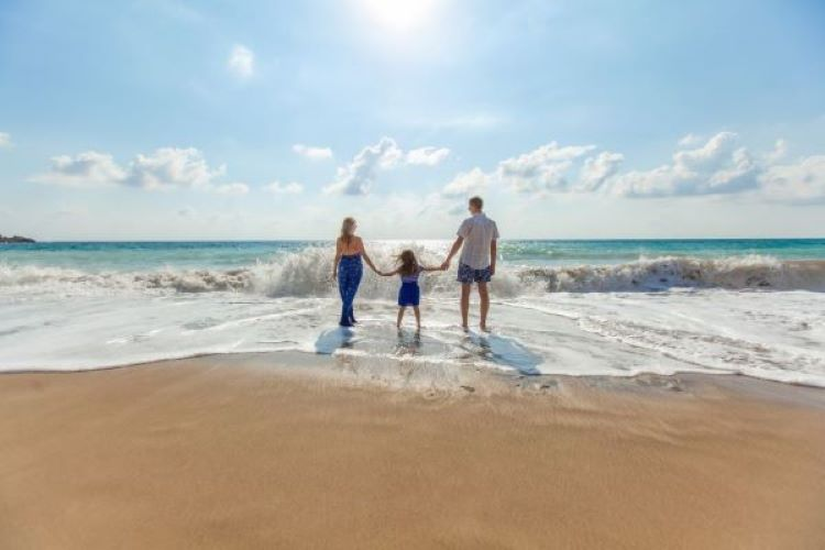 Parents and child present together and spending time on the beach