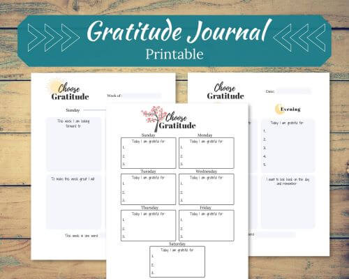 Wood Background with 3 different Gratitude Journal Printables in the forefront