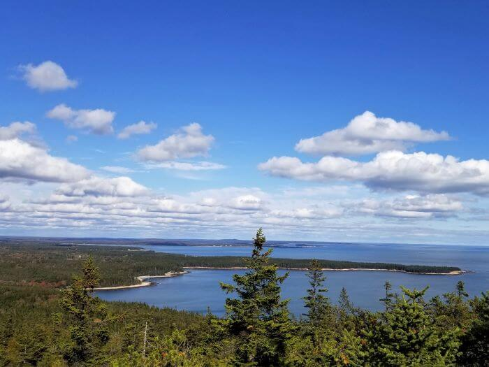 View of the pacific Ocean from a trail summit at Acadia National Park