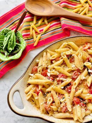 A dish of baked feta and tomato pasta