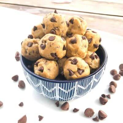 A bowl of no-bake cookie dough balls with chocolate chips