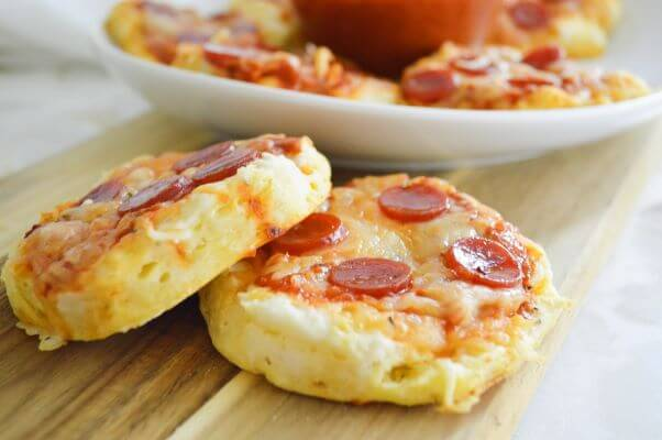 Mini Pizzas made on biscuits with cheese and pepperoni on top