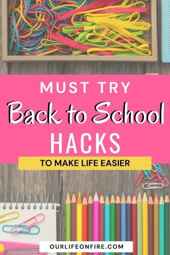 School supplies - paper clips, colored pencils and a note book